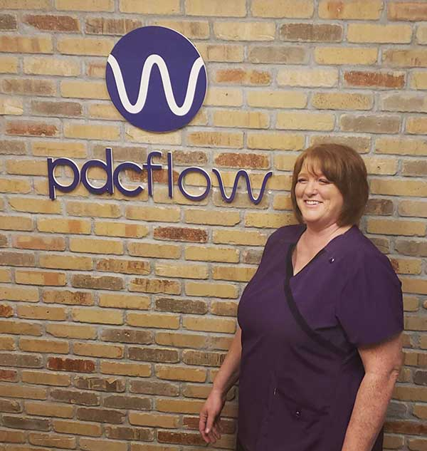 PDCflow corporate massage benefit promotes happy, healthy employees